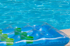 Summer pool and mattress Royalty Free Stock Image