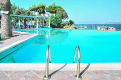 Summer dream. Pool overlooking the blue sea Stock Photography
