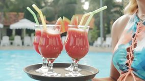 Summer pool party. Close up of fresh juice. stock video footage