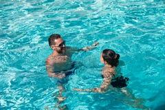 Summer pool resort. Life winner. Couple in pool. Pool party.