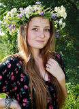 Summer portrait. Teenage long haired happy girl in garland Royalty Free Stock Photos