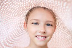 Summer portrait of a beautiful girl in a pink hat. The concept of childhood and vacations stock photos