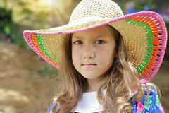 Summer portrait of beautiful little girl wearing straw hat Stock Photos