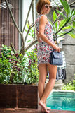 Summer portrait of a beautiful girl with sunglasses and luxury handmade snakeskin python handbag in the swimming Stock Photo