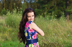 Summer portrait of a beautiful woman on nature background Royalty Free Stock Photo