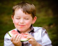 Summer portrait of  child eating watermelon Royalty Free Stock Images