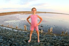 Summer portrait of a girl close-up, on a salt lake in the sunset, girl with contented and playful faces. Posing for a photo stock photography