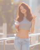 Summer portrait of a girl with a drink in the city Royalty Free Stock Photos