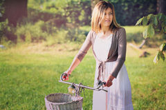 Summer portrait of a girl with old bicycle Stock Images