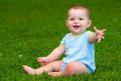 Summer portrait of happy baby boy infant outdoors. At park Stock Images