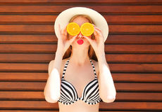 Summer portrait happy woman holds in hands oranges Royalty Free Stock Photography