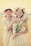 Summer portrait of happy women. Outdoor summer portrait of two happy women with stock photography