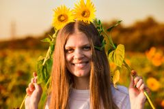 Summer portrait of happy young woman in hat with long hair in field enjoying nature. Summer portrait of happy young woman in hat with long hair in sunflower royalty free stock images