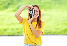 Summer portrait pretty smiling girl with vintage retro camera ha Royalty Free Stock Images