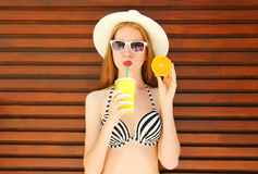 Summer portrait pretty woman and juice fruit cup with orange Royalty Free Stock Images