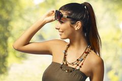 Summer portrait of girl. In sunglasses with pigtail stock photography