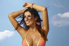 Summer portrait of woman. Summer portrait of beautiful woman in bikini top smiling happy stock photography