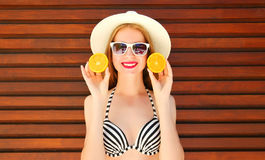Summer portrait smiling young woman holds in hands oranges Royalty Free Stock Photos