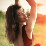 Summer portrait of smiling young woman outdoor shot summer day at grass field royalty free stock photos
