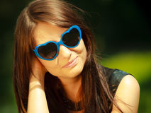 Summer. Portrait of woman in blue sunglasses outdoor Royalty Free Stock Photography