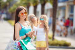 Summer portrait of a woman with colored bags Royalty Free Stock Photos