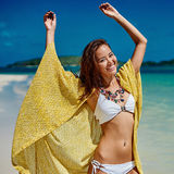 Summer portrait of young pretty woman having fun on a tropical b Royalty Free Stock Images