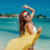 Summer portrait of young pretty woman having fun on a tropical b Stock Images