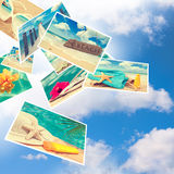 Summer Postcards. Floating summer postcards against a blue cloudy sky Stock Image
