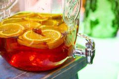 Summer punch with many fruits. Red summer punch with many fruits in it. During a party Stock Image