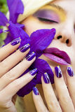 Summer purple yellow makeup and manicure . royalty free stock image