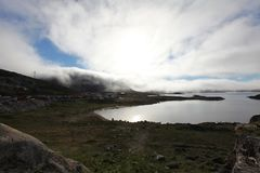 Summer in Qaqortoq. Fog over great lake Royalty Free Stock Photography