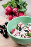 Summer radished and olives salad. Summer radishes and black olives salad Royalty Free Stock Images