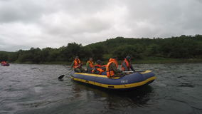 Summer rafting on Kamchatka in gloomy cloudy weather stock footage