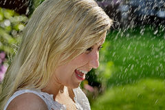 Summer rain. Close-up portrait of a beautiful teenager standing in the rain Royalty Free Stock Photo