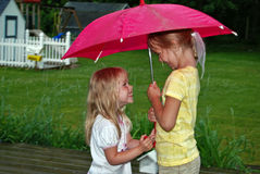 little wet girls under umbrella  Stock Image