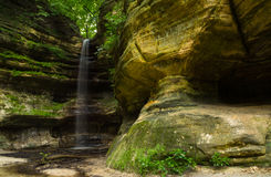 After the Summer rain. Canyon walls and cascade after the morning Summer rain in St. Louis Canyon.  Starved Rock State Park, Illinois, U.S.A Stock Image