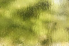 Summer rain drops on window glass background texture. Summer rain drops on window glass fresh background texture stock photos
