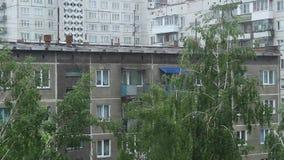 Summer rain outside the window, Rain in typical Russian residential area. Summer rain outside the window stock footage