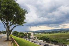 Summer rain in São José dos Campos - Brazil. Clouds and a summer rain on Anchieta Avenue in São José dos Campos, São Paulo - Brazil Royalty Free Stock Image