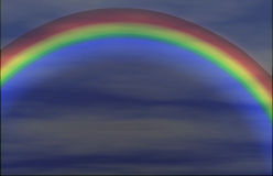 Summer rainbow background. In a cloudy sky Royalty Free Stock Images