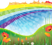 Summer rainbow landscape. Summer blooming meadow and rainbow in the sky Stock Image
