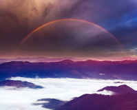 Summer rainbow in mountains Stock Photos