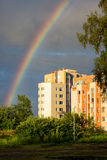 Summer rainbow over residential buildings Royalty Free Stock Photography