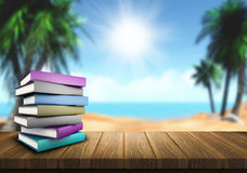 Summer reading. 3D render of a pile of books on a wooden table looking out to a sandy beach Stock Photo