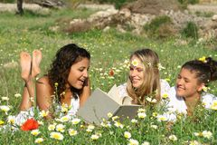 Summer Reading  outdoors. Happy friendly smiling youth reading outdoors in summer Royalty Free Stock Photo