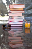 Summer - reading time. A stack of old books in the sun in summer Royalty Free Stock Image
