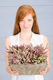 Summer redhead woman hold basket with flowers. Summer portrait of redhead woman hold basket with flowers royalty free stock image