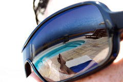 Summer Reflections. Relaxing vacation / holiday scene reflected in sunglasses Stock Photo