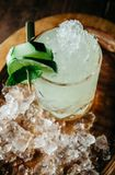 Summer refreshing alcoholic cocktail garnished with cucumbers an stock images