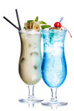 Summer refreshing cocktails. Blue lagoon and banana colada Stock Images